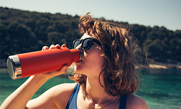 girl-drinking-water-reusable-bottle