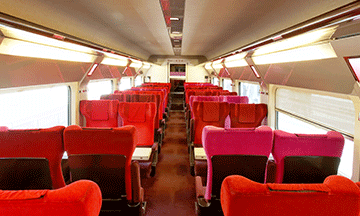 inside-high-speed-train-thaly-red-seats