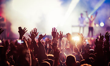 people-at-concert-hands-in-the-air